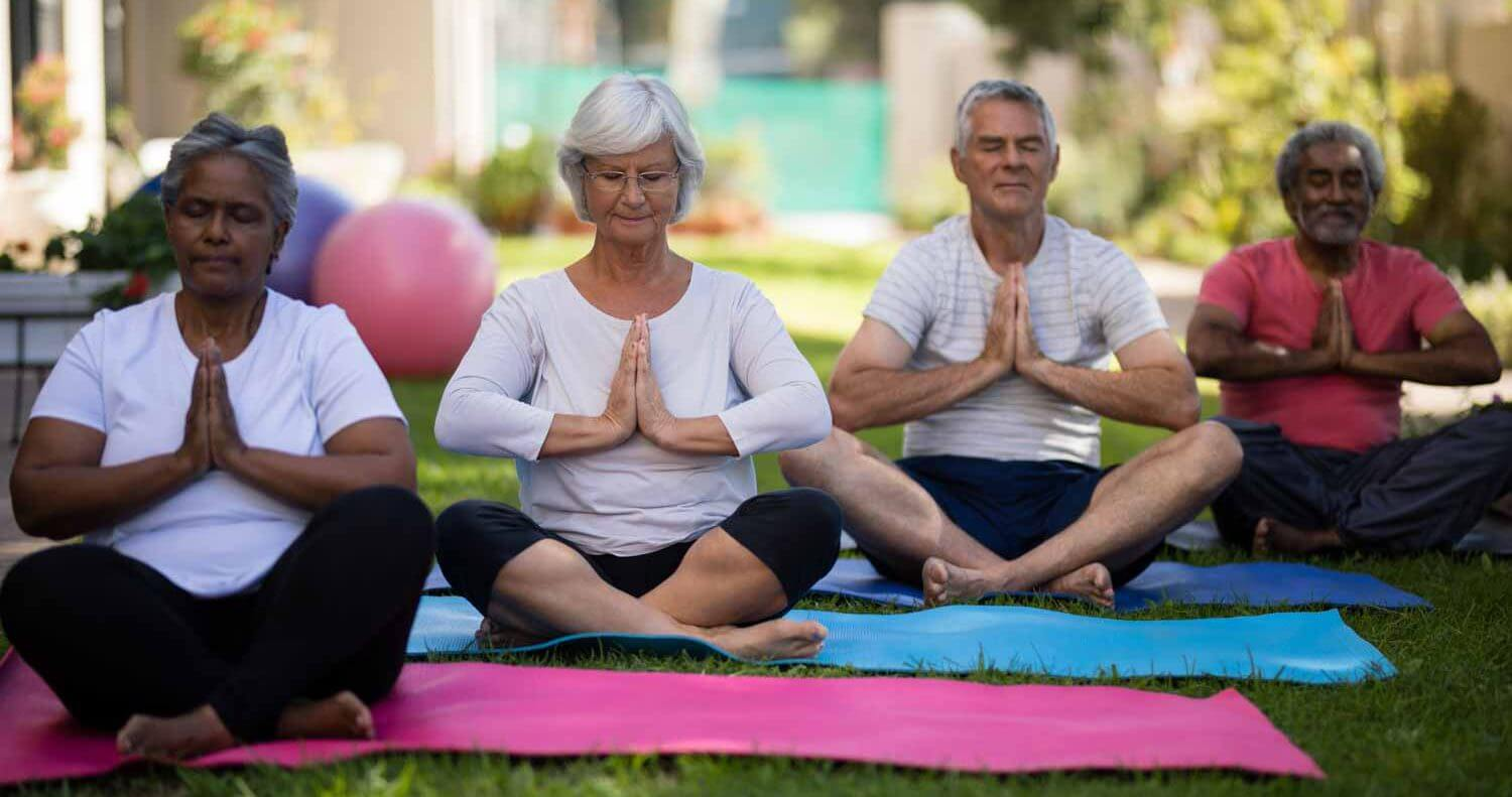 residents doing lawn yoga