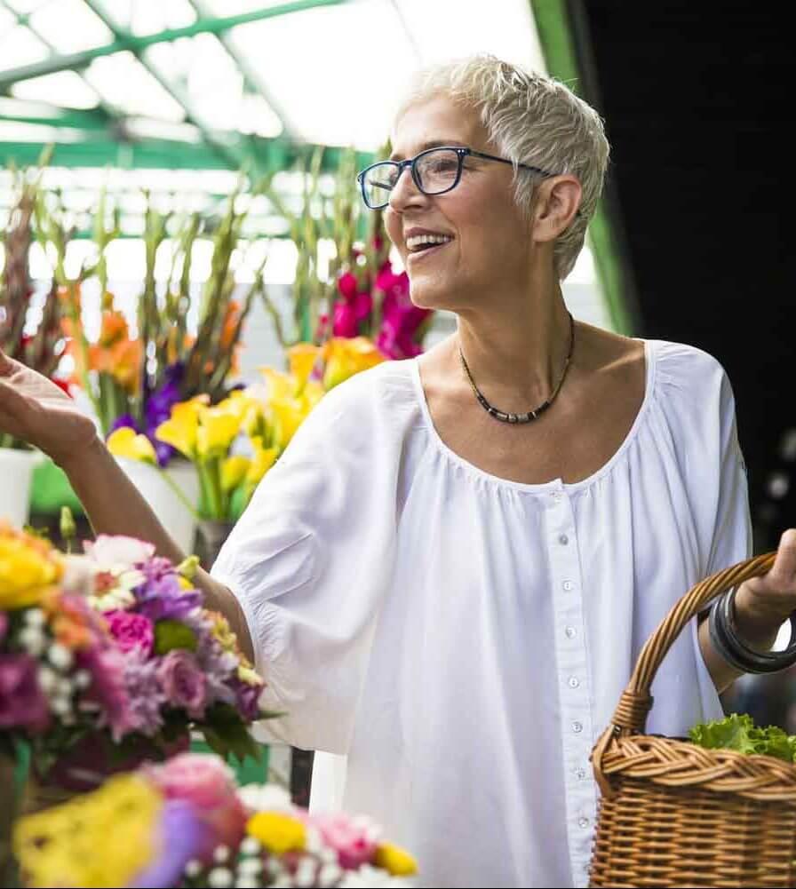 senior woman buying flowers